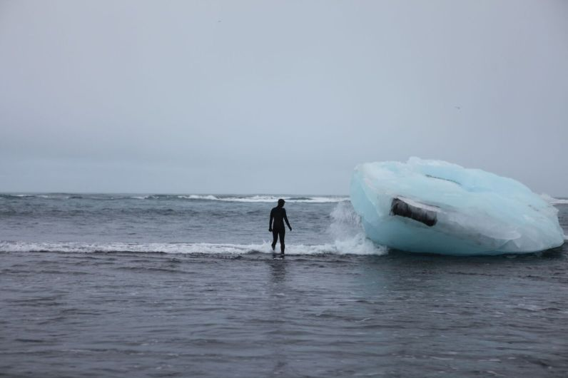 Contributer Kaitlyn Tolin Productions stands next to a glacier in Iceland.